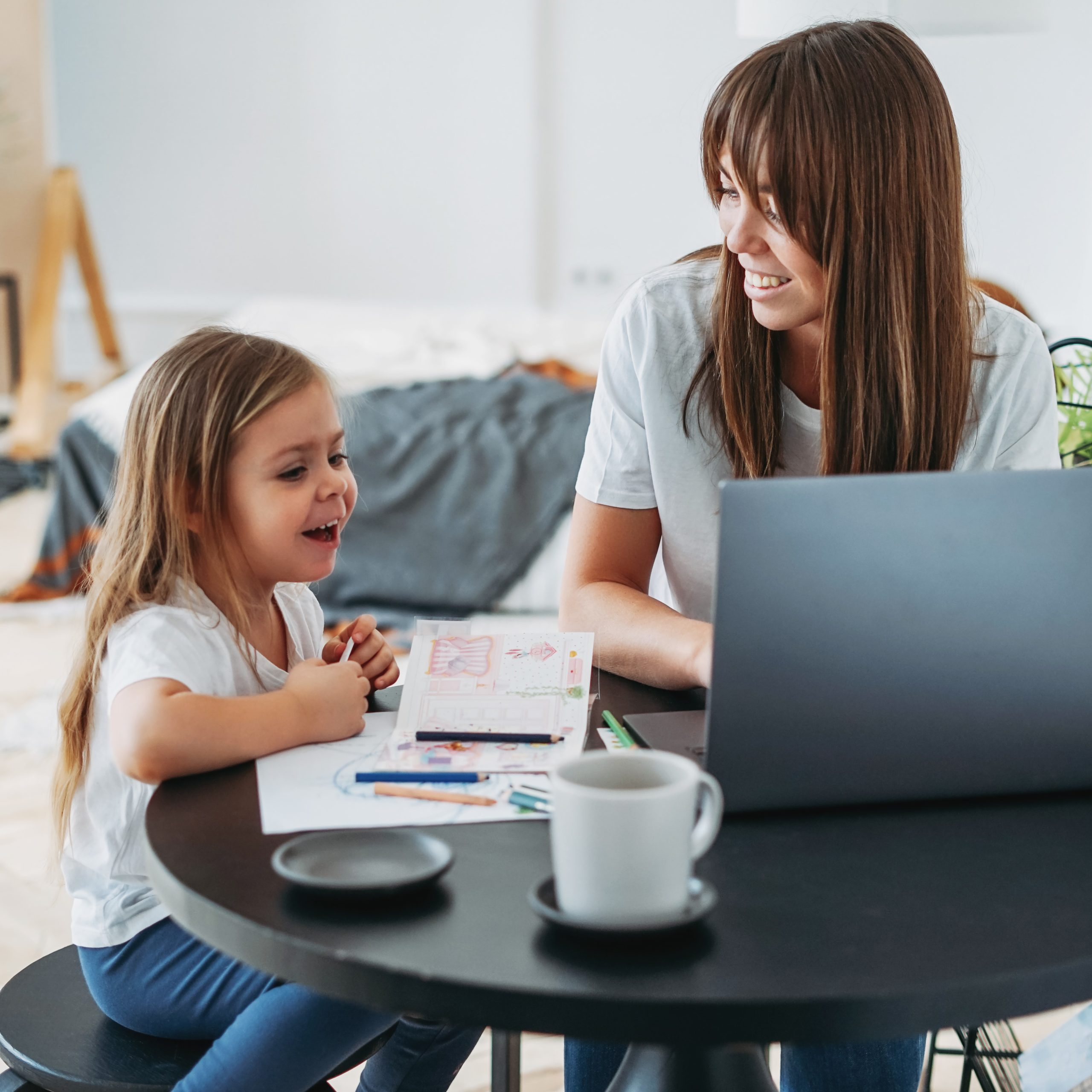 momdaughtercomputer scaled - 7 Kid Friendly Activities You Can Do At Home